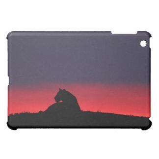 Lioness (Panthera leo) sitting, at sunset, Masai iPad Mini Case