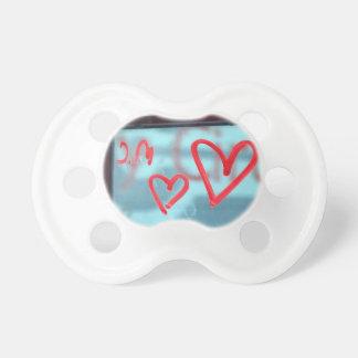 Lipstick heart on window pacifier