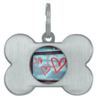 Lipstick heart on window pet name tag