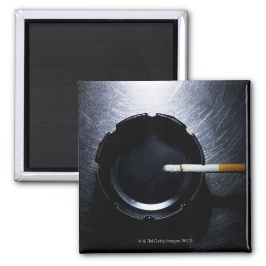 Lit Cigarette and Ashtray on Stainless Steel Magnet