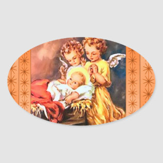 Little angels at the manger oval sticker