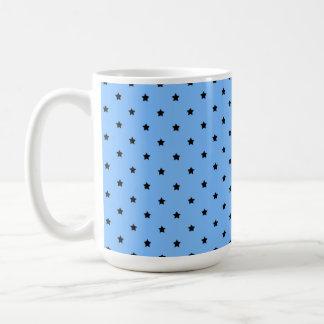Little black stars on a light blue background. coffee mug