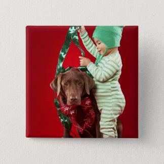 Little boy decorating a dog 15 cm square badge