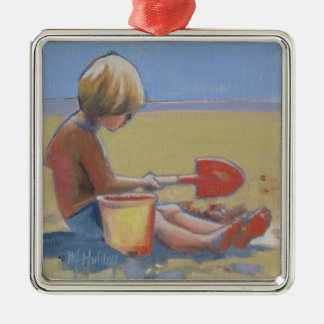Little boy playing in the sand with a shovel christmas ornament