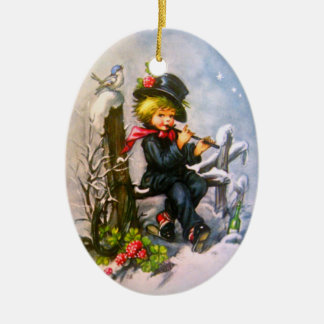 Little Boy with Flute Double-Sided Oval Ceramic Christmas Ornament