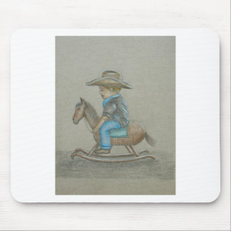little cowboy riding on toy horse mouse pad