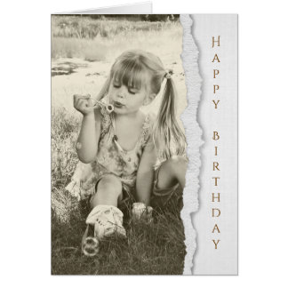 little girl blowing bubbles for birthday greeting card