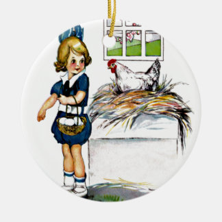 Little girl collecting eggs christmas ornament