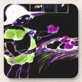 Little girl in a floppy hat with hatching chicks drink coasters