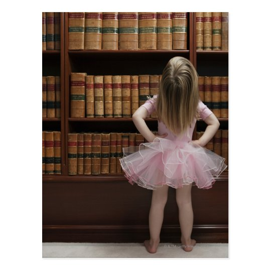 little girl in tutu reading book covers in