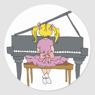 little girl playing piano round sticker