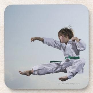 Little girl practicing karate drink coaster