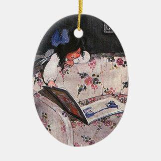 Little Girl reading over sofa Christmas Ornament