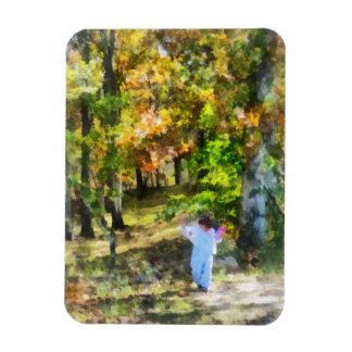 Little Girl Walking in Autumn Woods Rectangular Photo Magnet