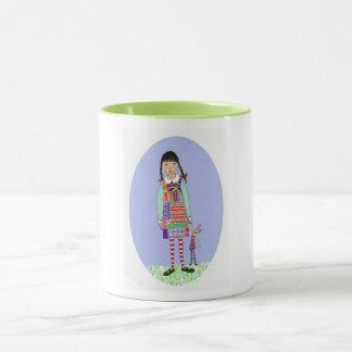 Little girl with bunny toy mug
