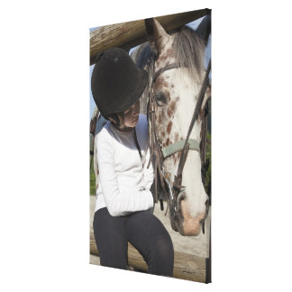 Little girl with her horse canvas print