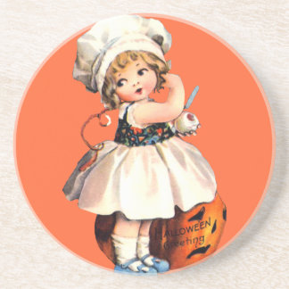 little girl with pumpkin coasters