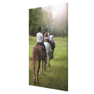 Little girls riding horses canvas print