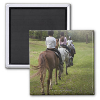 Little girls riding horses square magnet