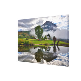 Little House in Mist on Lake Canvas Print