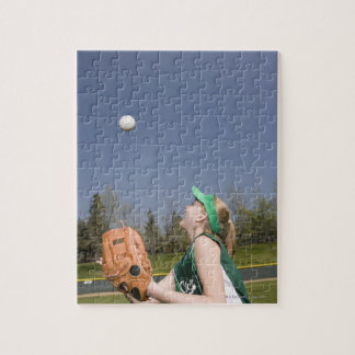 Little league player catching ball puzzles