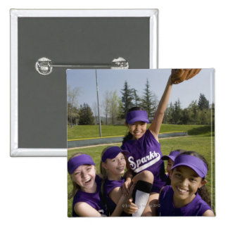 Little league players carrying teammate 15 cm square badge
