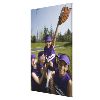 Little league players carrying teammate canvas print