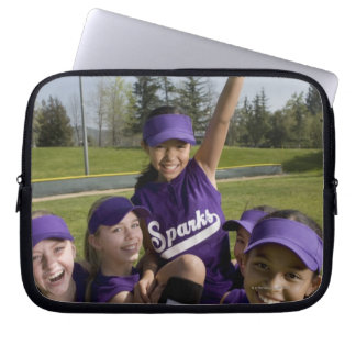 Little league players carrying teammate laptop sleeve