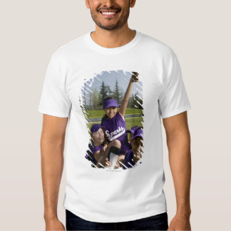 Little league players carrying teammate tee shirt