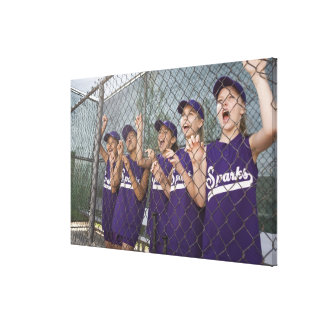 Little league team cheering in dugout canvas print