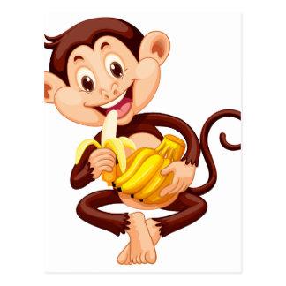 Little monkey eating banana postcard