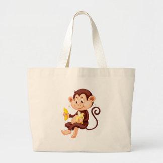 Little monkey eating bananas jumbo tote bag