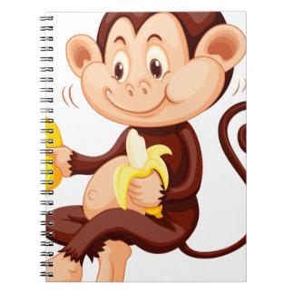 Little monkey eating bananas notebooks