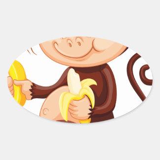 Little monkey eating bananas oval sticker