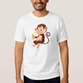 Little monkey eating bananas t-shirts