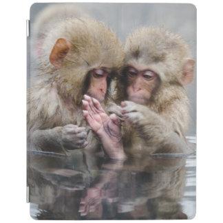 Little monkeys in hot spring, Japan. iPad Cover