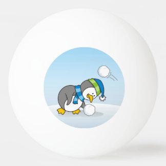 Little penguin getting a snow ball