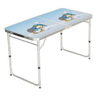 Little penguin getting a snow ball beer pong table