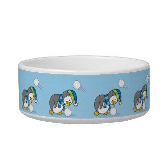 Little penguin getting a snow ball bowl
