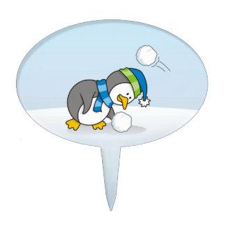 Little penguin getting a snow ball cake pick