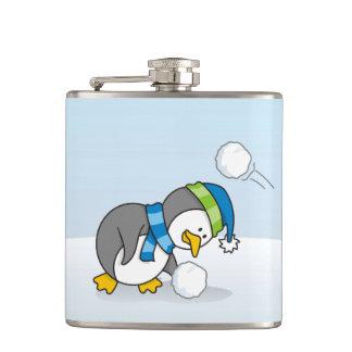Little penguin getting a snow ball flask