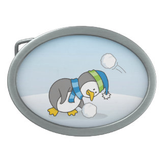 Little penguin getting a snow ball oval belt buckle