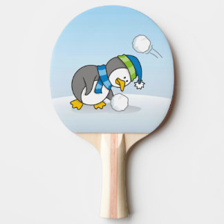 Little penguin getting a snow ball ping pong paddle