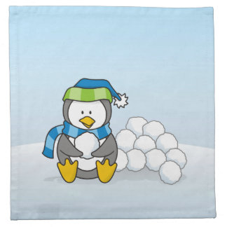 Little penguin sitting with snowballs napkin