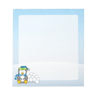 Little penguin sitting with snowballs notepad