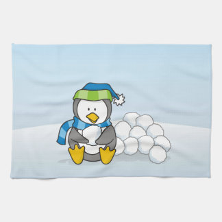Little penguin sitting with snowballs tea towel