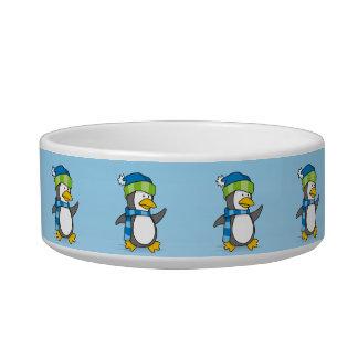 Little penguin walking on snow bowl