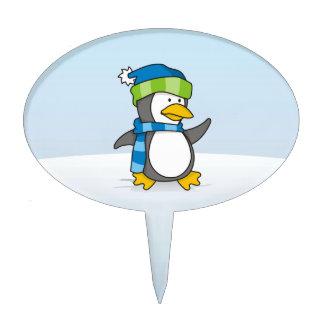 Little penguin walking on snow cake pick