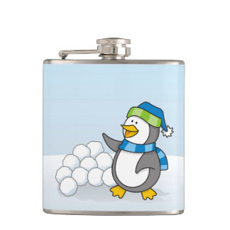 Little penguin with snow balls waving hip flask