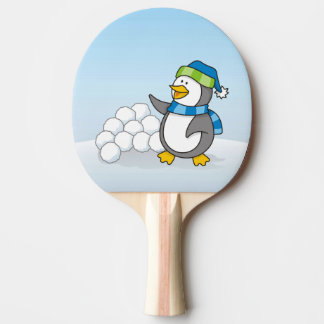 Little penguin with snow balls waving ping pong paddle